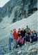 Группа туристов Знаменитой Тридцатки на малом леднике горы Фишт - классическая нивальная зона, на дальнем фоне двух сот метровый водопад. Нивальная зона - это зона голых скал. вечных льдов и снегов.